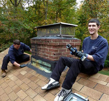 Danbury Chimney Cleaning - working on the roof